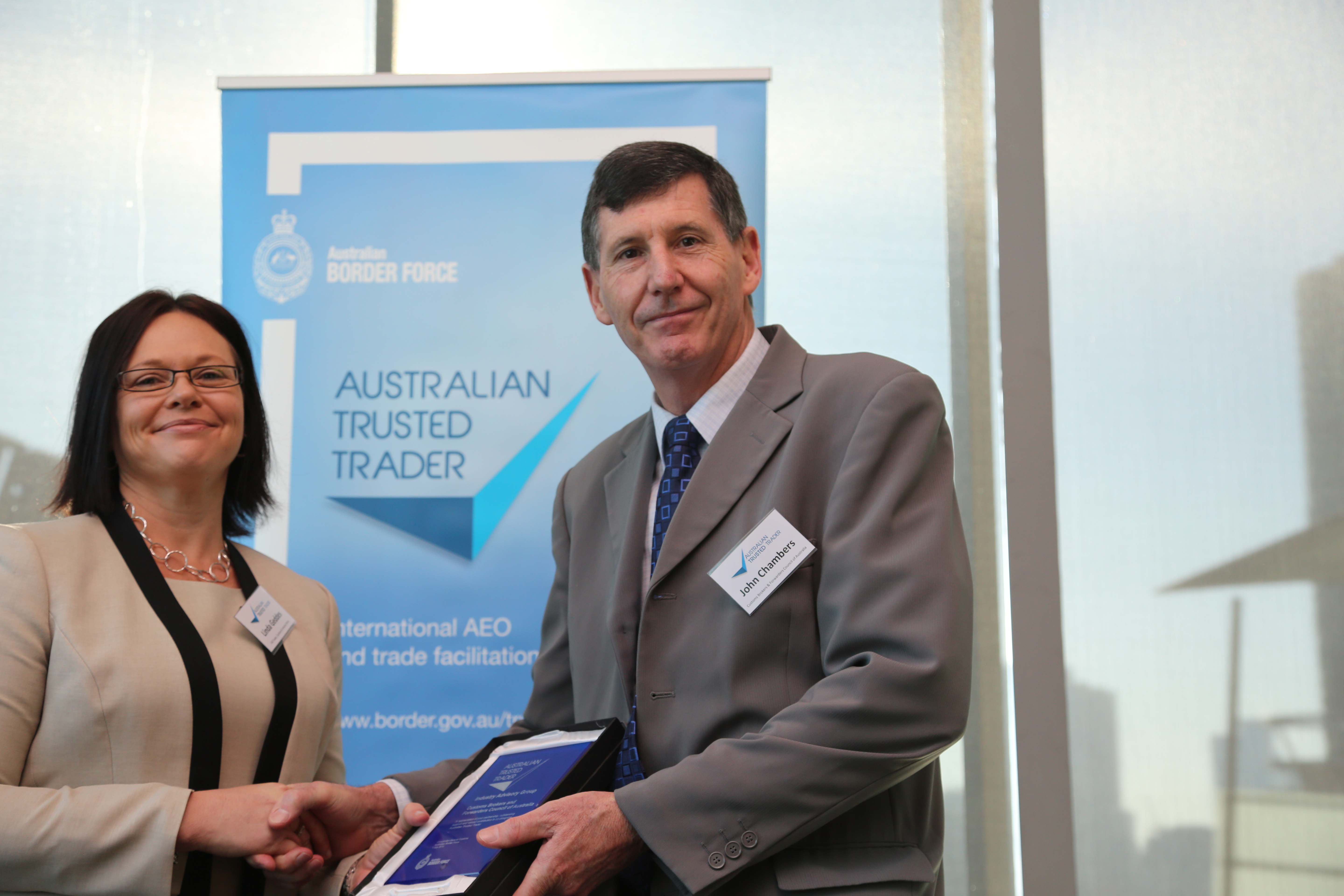 Streamlined trade a step closer trade customs and industry policy division linda geddes and cbfca chair john chambers celebrating the launch of australian trusted trader malvernweather Images